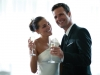 bride-and-groom-raising-glasses-during-toast