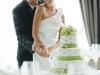 bride-looking-at-groom-cutting-cake