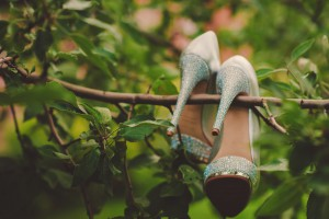 Wedding shoes hanging on a tree in the park