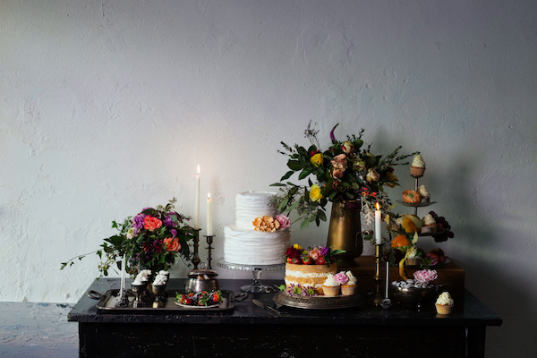Wedding sweet table inspired by Dutch masters still lifes. Dark shadows, window light, grain, shallow depth of field.