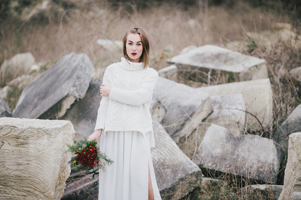 Winter wedding. Beautiful young bride posing near lake